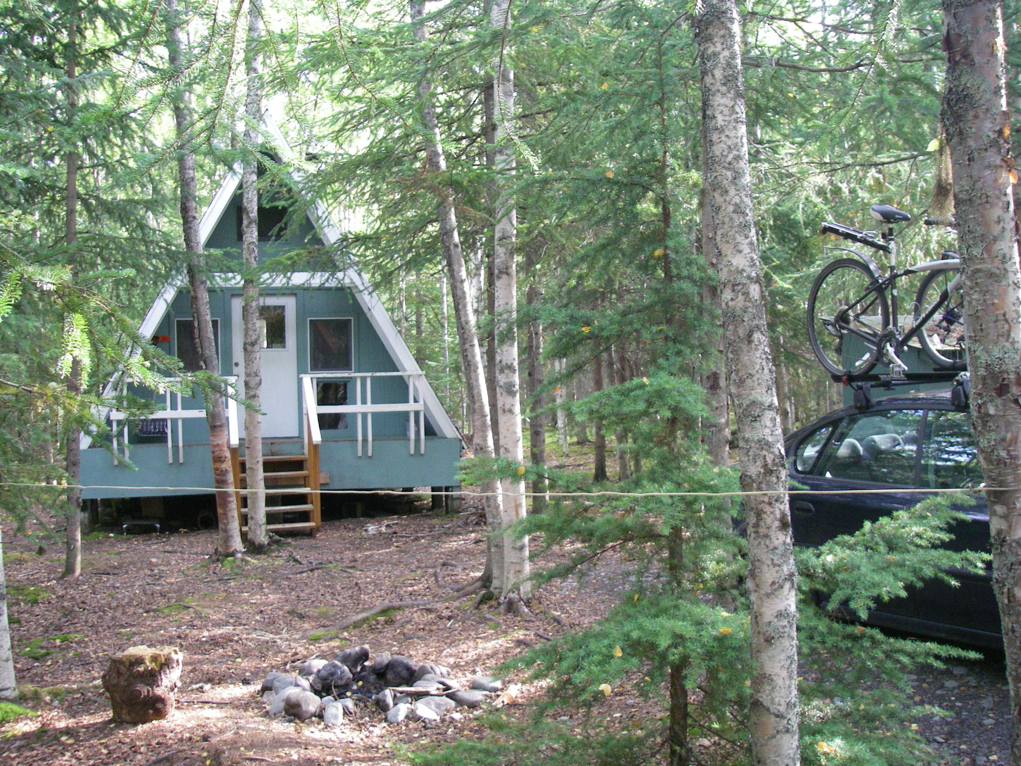 cabin booking hotel ak image village us bluff com rentals on this gulch of cabins alaska gallery clam resort the property