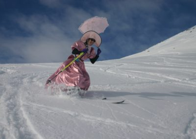 2nd Place Rec/Casual Skiing: Terri Pauls wears her best while doing tele turns by Joe Kurtak
